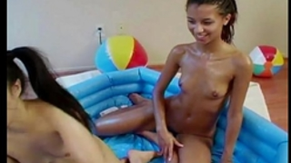 Messy legal age teenager lesbian babes having joy in empty pool