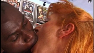 Ginger mama takes on a dark and white jock