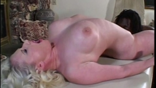 Hot milf with a youthful dark male for some interracial sex