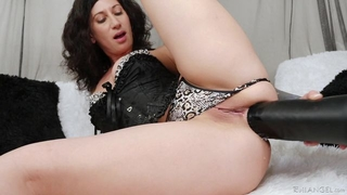 Raven-haired camgirl with tattoos fucks herself with massive black dildo