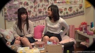 Adorable Asian lady pleasuring her lesbian friend