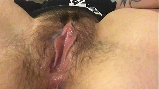 Rub my unshaved love button and receive my fingers moist