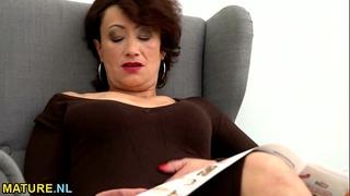 Hairy older pleasures herself on the ottoman