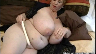 Fat granny dagny with her large milk sacks plays with sex-toy
