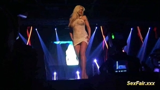 Blonde receives fake penis in live show