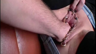 Fist fucking her heavily pierced gaping fur pie