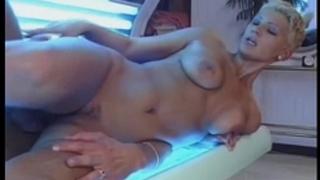 Busty golden-haired girlfriend sucks and bonks in a solarium